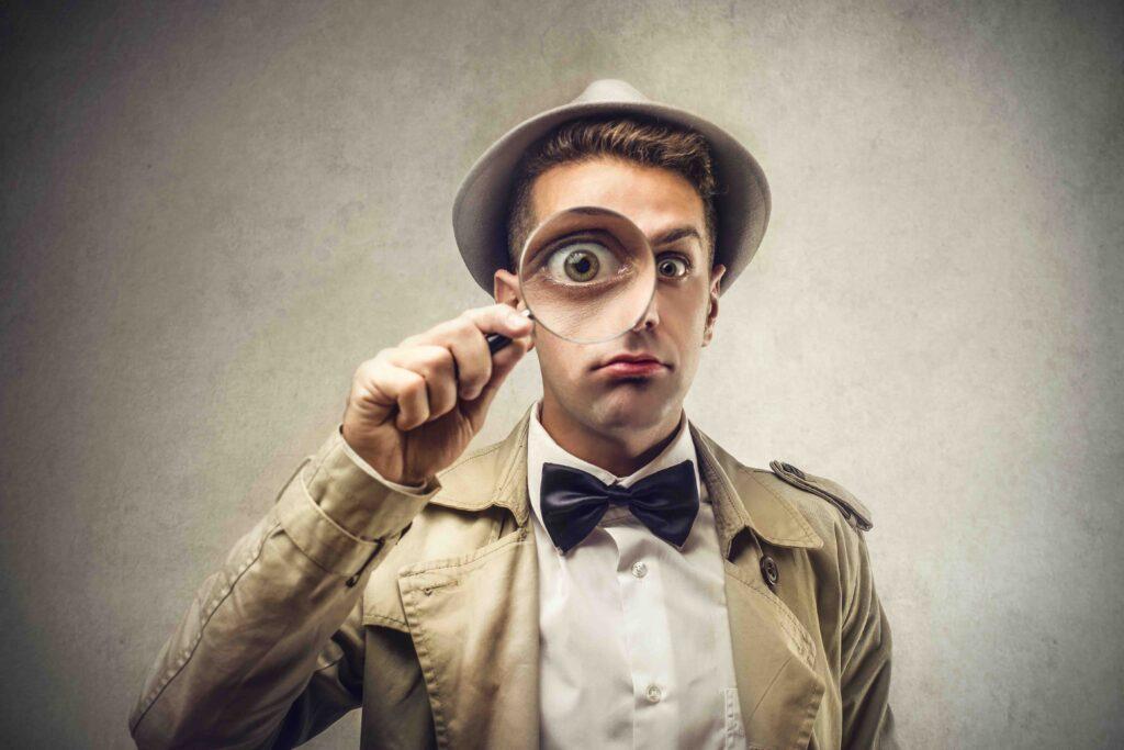 Gesellschaftsspiele: Detektiv mit Lupe
