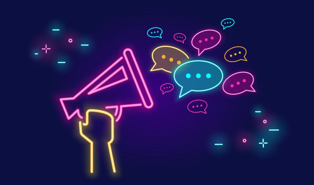 Neon Schild mit Megafon und Sprechblasen